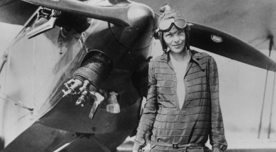 Amelia Earhart stands in front of her biplane called 'Friendship' in Newfoundland on June 14, 1928.  (Photo by Getty Images)