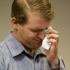Allen Steed wipes away a crocodile tear while testifying in court (Photo by Douglas C. Pizac-Pool/Getty Images)