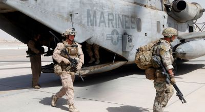 U.S. Marines with Golf Company, 2nd Battalion, 8th Marines (2/8), Afghan Territorial Force 444 (ATF-444) and British soldiers exit a CH-53E Super Stallion assigned to Marine Heavy Helicopter Squadron 462 (HMH-462) at Camp Bastion, Helmand province, Afghanistan, Aug. 31, 2013. HMH-462 transported 2/8, ATF-444 and British soldiers during a joint interdiction operation. (U.S. Marine Corps photo by Sgt. Gabriela Garcia/Released)