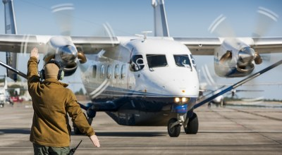 A 919th Special Operations Maintenance Group Airman marshals a C-145A Skytruck toward its mission at Duke Field, Fla. The Skytrucks are primarily used for new aircrew qualifications and flight proficiency missions. (U.S. Air Force photo/Tech. Sgt. Sam King).