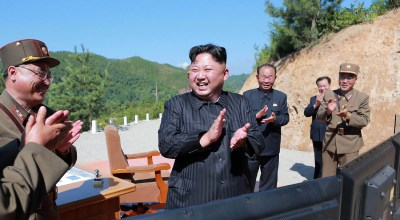 North Korean leader Kim Jong Un celebrating the successful test-fire of the intercontinental ballistic missile Hwasong-14 at an undisclosed location in July, 2017. (AFP PHOTO/KCNA VIA KNS/Getty Images)