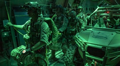 U.S. Air Force pararescuemen with the 82nd Expeditionary Rescue Squadron, deployed in support of Combined Joint Task Force - Horn of Africa (CJTF-HOA), prepare to conduct a static line jump from a C-130J Hercules as part of joint personnel recovery training near Grand Bara, Djibouti, on December 6, 2018. (U.S. Air Force Photo by Tech Sgt. Chris Hibben)