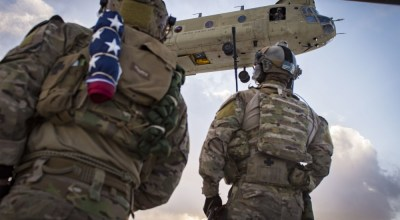 U.S. Air Force pararescuemen, assigned to the 83rd Expeditionary Rescue Squadron, prepare to board a U.S. Army CH-47F Chinook during a training mission in Afghanistan, March 15, 2018. Pararescuemen conduct training on combat, medical procedures and search and rescue to hone their skills, providing the highest level of personnel recovery capabilities to commanders throughout the Combined Joint Operations Area - Afghanistan. (U.S. Air Force photo by Senior Airman Nathaniel Stout).