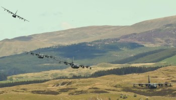 Watch special operations pilots take four C-130s on low passes through the Mach Loop