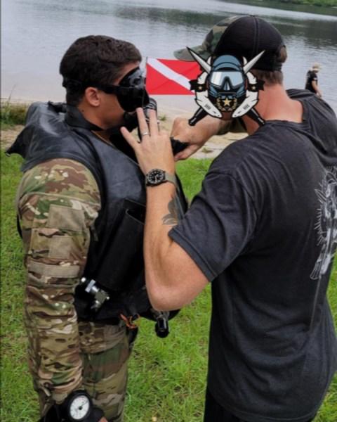 Pre-dive inspections on a Combat Dive Competition participant.