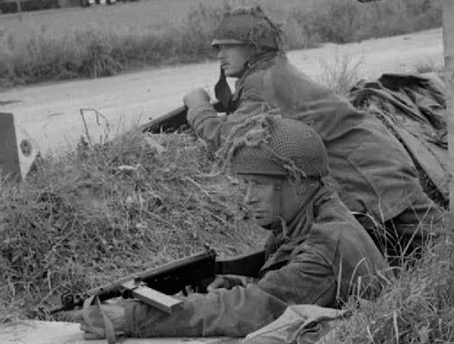 British soldiers fire a Sten gun during WWII.