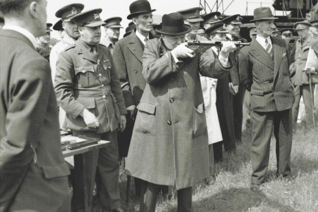Winston Churchill fires a Sten gun.