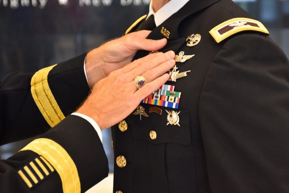 """Col. Andrew R. """"Drew"""" Morgan receives the Army astronaut device from Lt. Gen. Daniel L. Karbler, commanding general of U.S. Army Space and Missile Defense Command, during a May 5, 2021, ceremony at the National Museum of the United States Army at Fort Belvoir, Virginia. (U.S. Army photo by Ronald Bailey)"""