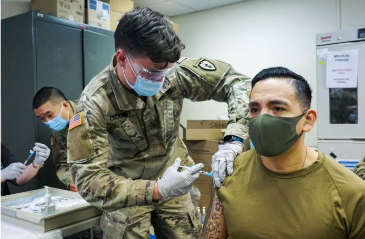Biden Urges Pentagon to Make COVID Vaccine Mandatory