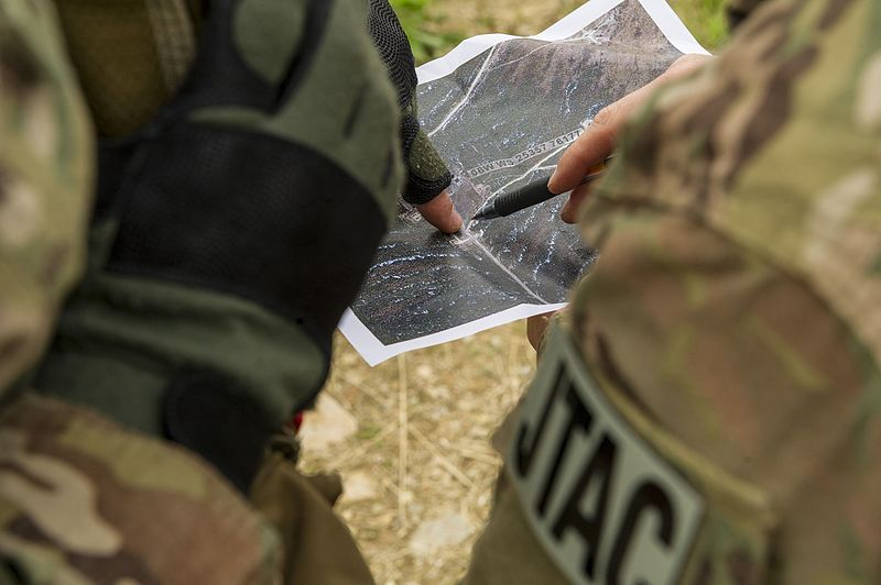 U.S. Air Force joint terminal attack controllers plot target data on a map.