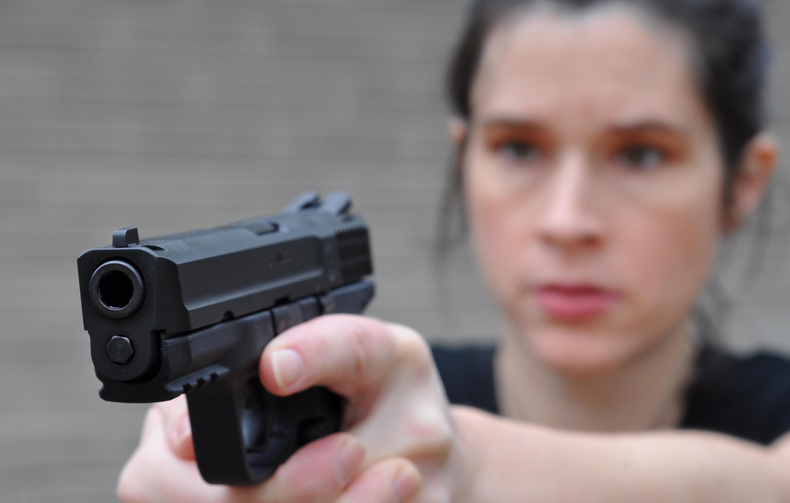 Woman shooting gun