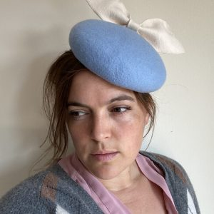 Pale blue button with cream bow