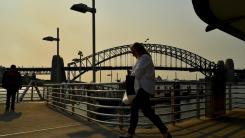 The Sydney Harbour Bridge as smoke haze from bushfires in New South Wales blankets the Sydney CBD. Picture: AAP