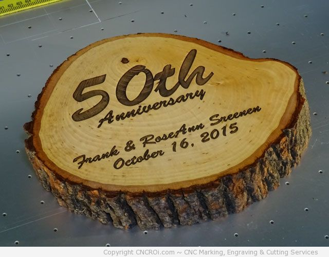 cnc-laser-wood-log-1 CNC Laser Engraving A 50th Anniversary Log