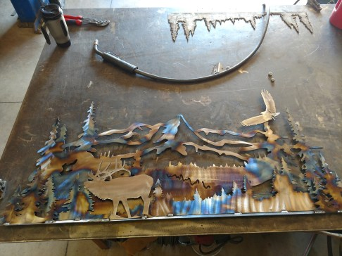 mountain scene torched with elk