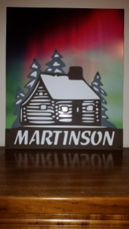 northern lights with brown cabin - layered