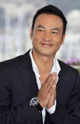Chinese actor Simon Yam poses during a p