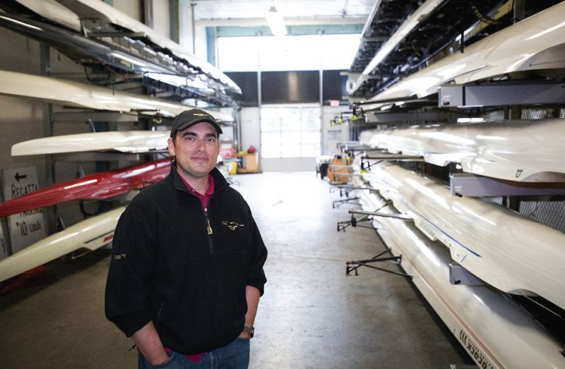 PORTLAND TRIBUNE: JAIME VALDEZ - Nick Haley, vice president at Portland Boathouse, stands amid storage racks at its facility along Southeast Water Avenue. The rowing and paddling community is trying to land a new home near the river.