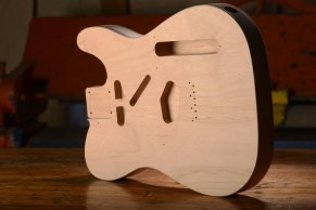 Wooden guitar body made by Marty Bonacci at CNM Makerspace.