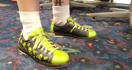 Manuel Lujan, CNM staff member with Ace Computer Labs and Bowling student shows off his own bowling shoes he found online. (Hay/CNM CHronicle)