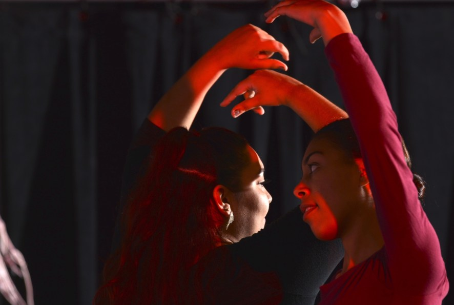 Illiana Smith (right) and Yuneci Vallejos (left) perform a Sevillanas flamenco dance. (Wade Faast/CNM Chronicle)