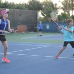 Junior tennis players double up to raise money