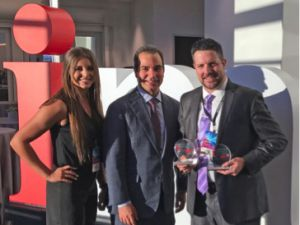 (L-R) Liz Mirand and Sinan Kanatsiz of IMA, and Daniel Taugher of DoT with awards