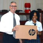 Cayman Academy student wins laptop