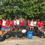 Swim club dives into Earth Day clean-up