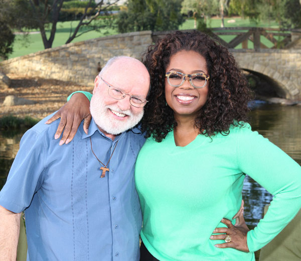 "Franciscan Father Richard Rohr poses for a photo with Oprah Winfrey on the set of ""Super Soul Sunday"" during the taping of an episode running on OWN, the Oprah Winfrey Network, Sunday, Feb. 8, 11 a.m. ET.  (CNS/courtesy Harpo Inc.)"