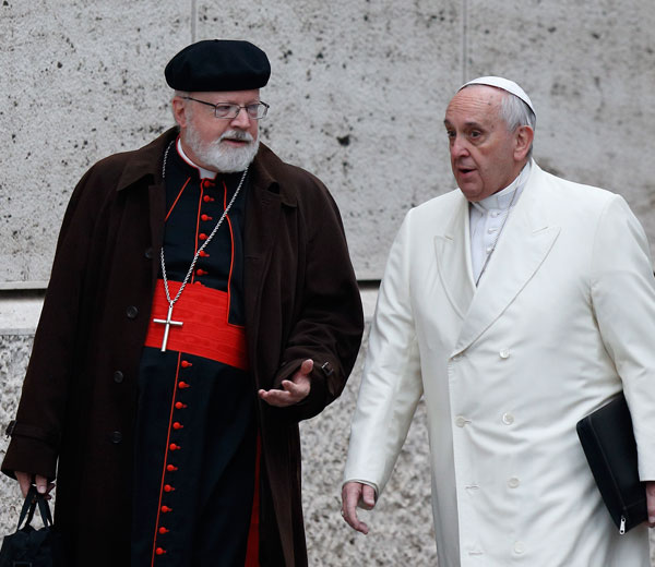Pope Francis talks with Cardinal Sean P. O'Malley of Boston as they arrive for a meeting in the synod hall at the Vatican Feb. 13. The pope, cardinals and cardinals-designate were meeting for two days to discuss the reform of the Roman Curia in advance of a Feb. 14 consistory. (CNS/Paul Haring)