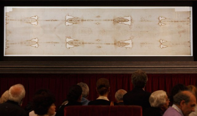 People view the Shroud of Turin on display at the Cathedral of St. John the Baptist in Turin, Italy, in 2010. (CNS/Paul Haring)