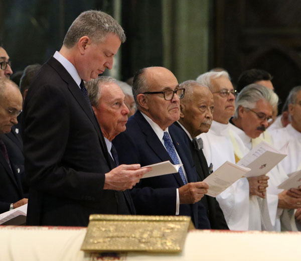 New York Mayor Bill de Blasio stands near the casket at Cardinal Edward M. Egan's funeral Mass at St. Patrick's Cathedral in New York City March 10. Also visible are three former New York mayors: Michael Bloomberg, Rudy Giuliani and David Dinkins. (CNS/Gregory A. Shemitz)