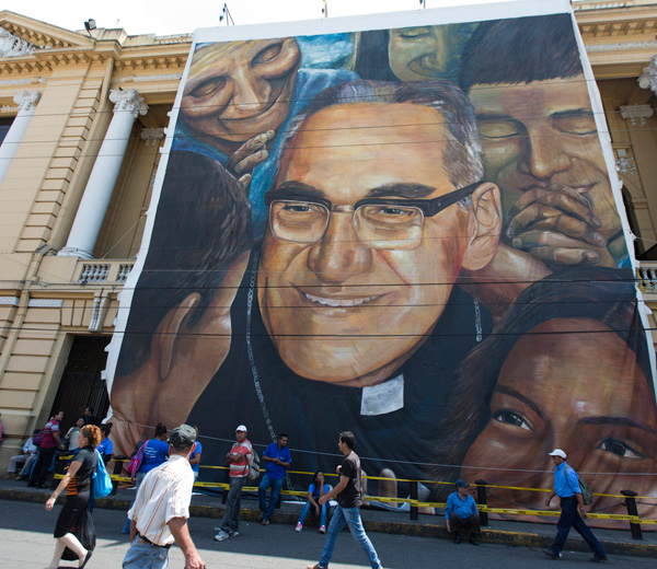A large canvas depicting Archbishop Oscar Romero hangs on the facade of the National Theater in San Salvador, El Salvador, March 24, 2015, the 35th anniversary of his assassination. (CNS file/Octavio Duran)