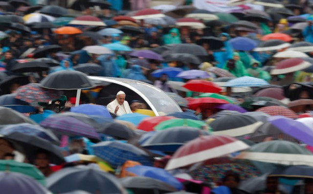 Rain falls as Pope Francis arrives to lead his general audience in St. Peter's Square at the Vatican March 25. (CNS/Paul Haring)