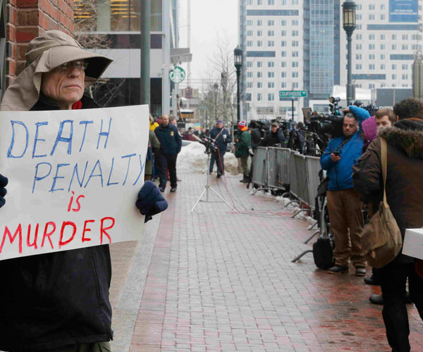 A man expresses his views on capital punishment March 4 outside the trial of accused Boston Marathon bomber Dzhokhar Tsarnaev in Boston. (CNS/Reuters)