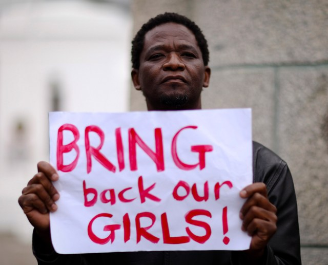 A protester holds a sign during a May 8 march in Cape Town, South Africa, in support of the girls kidnapped in Nigeria. The Islamist militant group Boko Haram claimed responsibility for the abduction of 276 schoolgirls during a raid in the remote village of Chibok in April. (CNS photo/Sumaya Hisham, Reuters)
