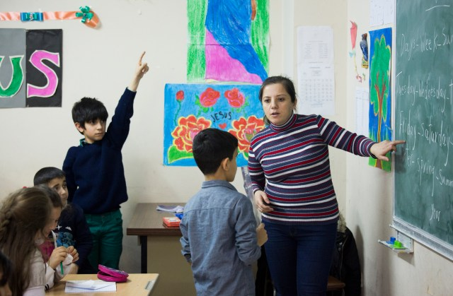 Iraqi refugee Basima Toma teaches English class at Don Bosco youth center in Istanbul.  (CNS/Elie Gardner)