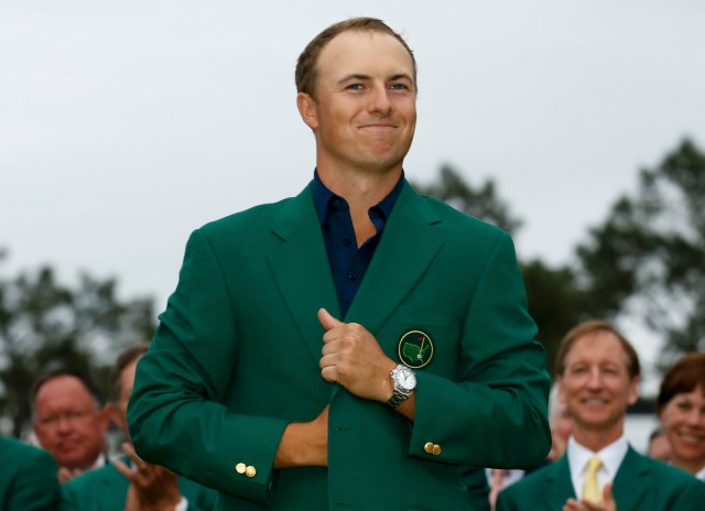 Golfer Jordan Spieth wears his champion's green jacket at the Augusta National Golf Club in Georgia after winning the Masters golf tournament April 12. (CNS/Reuters)