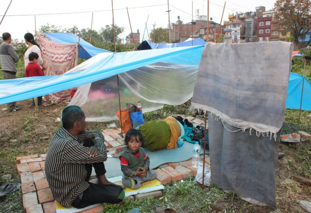 A family takes shelter April 28  in Kathmandu, Nepal, following Nepal's earthquake. (CNS/Anto Akkara)