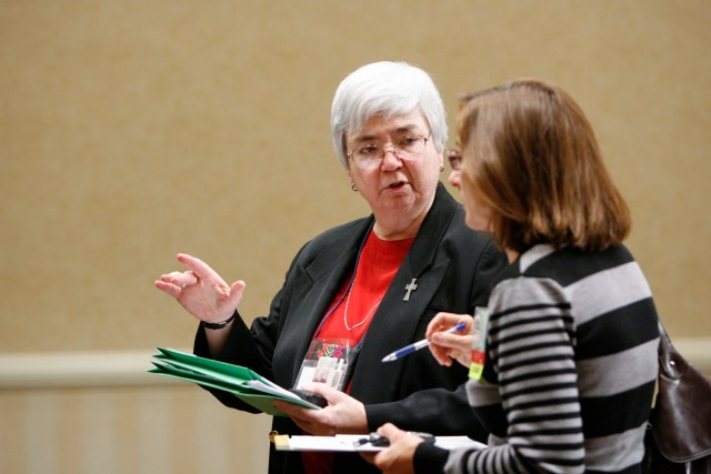 Mercy Sister Mary Ann Walsh talks with a journalist during the U.S. bishops' fall 2007 meeting in Baltimore. (CNS/Nancy Wiechec)