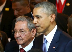 Cuban President Raul Castro stands with U.S. President Barack Obama before the inauguration of the seventh Summit of the Americas in Panama City April 10. (CNS/handout via Reuters)