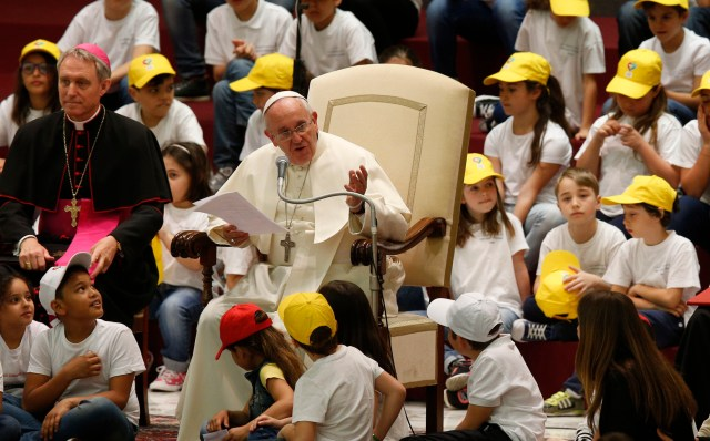 "Pope Francis leads an audience with children from the Fabbrica della Pace group at the Vatican May 11. In English the group is called the ""Peace Factory."" (CNS/Paul Haring)"
