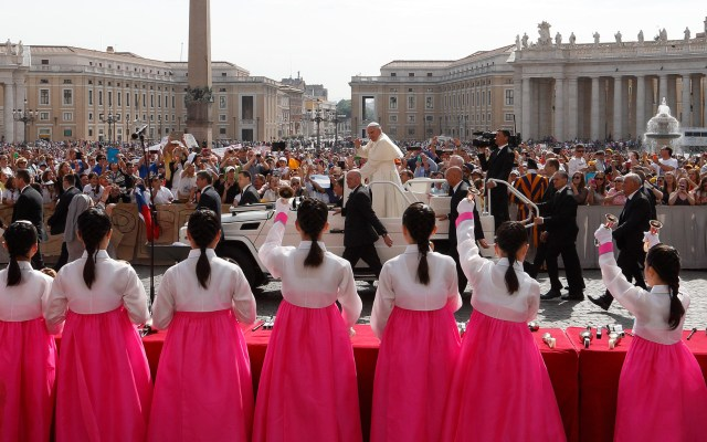 "Members of the Daegu ""Pueri Cantores"" choir from South Korea play bells as Pope Francis greets the crowd during his general audience in St. Peter's Square May 20. (CNS/Paul Haring)"