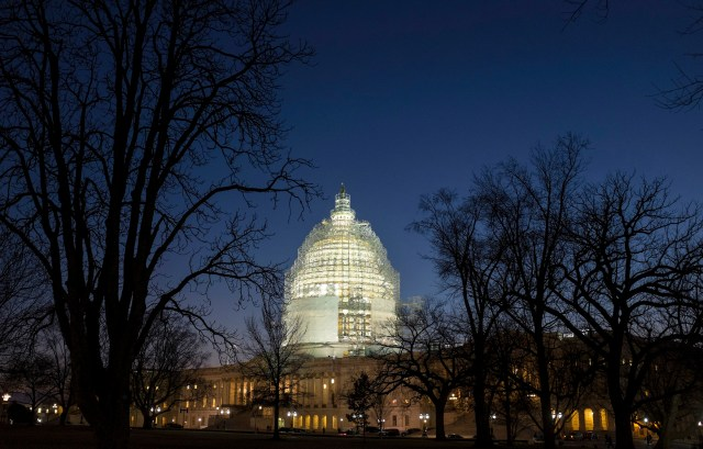 The U.S. Capitol in Washington is seen lighted at night. (CNS photo/Joshua Roberts, Reuters)