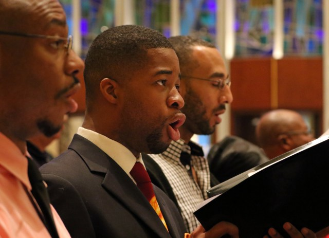 Men sing during a special evening prayer service at Holy Family Church in New York City. The liturgy was celebrated to draw attention to the ongoing persecution and killing of Christians in Africa. (CNS/Gregory A. Shemitz)