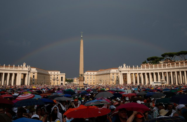 A rainbow is seen as Pope Francis attends a meeting with Catholic charismatics in St. Peter's Square at the Vatican July 3. (CNS/Paul Haring)