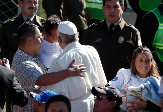 Watched by prison guards, Pope Francis greets prisoners and family members during a visit to the Palmasola prison in Santa Cruz, Bolivia, July 10. (CNS/Paul Haring)