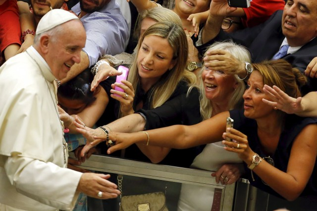 People react as Pope Francis arrives to lead his weekly audience in Paul VI hall at the Vatican Aug. 5. (CNS/Reuters)