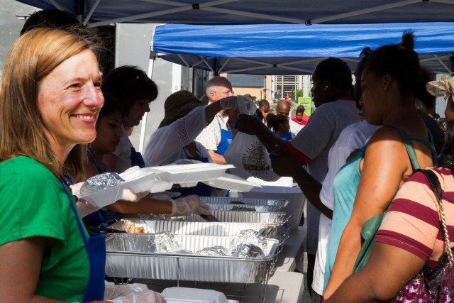 Washington volunteer Kristen Vibbert greets homeless men and women at a Catholic Charities-sponsored St. Maria's Meals Program dinner held every Wednesday evening in the nation's capital. Pope Francis is scheduled to visit the homeless food initiative Sept. 24 during the Washington leg of his U.S. visit. (CNS/Chaz Muth)